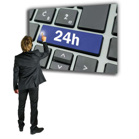 activating: Conceptual image of a businessman activating a 24h key on a computer keyboard depicting access to twenty four hour online support, service and assistance
