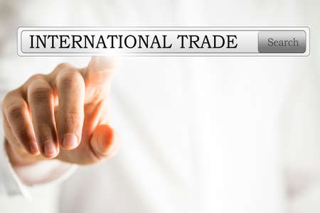 international sales: Close-up of a hand clicking a bar button to search for international trade on a virtual screen, with copy space