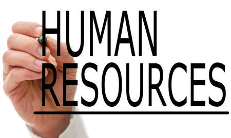 resource management: Man writing Human Resources on a virtual screen with a marker pen conceptual of employment, recruitment and manpower Stock Photo