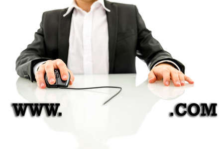 hypertext: Businessman accessing a web address with the text www - blank copyspace - dot com - in the foreground with the mans hand holding a computer mouse wired to the text in the background