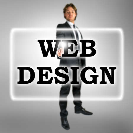 activating: Businessman in a Web Design concept with the words in a navigation bar on a virtual interface or screen and a stylish young businessman standing activating the button with his finger from behind Stock Photo