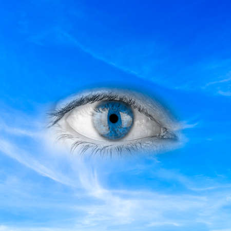 Conceptual image depicting - Save planet earth - with an eye in blue sky depicting awareness, responsibility, watching over and protecting nature and a clean pure environment photo
