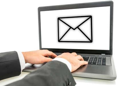 sent: Businessman sending email correspondence online on his laptop computer