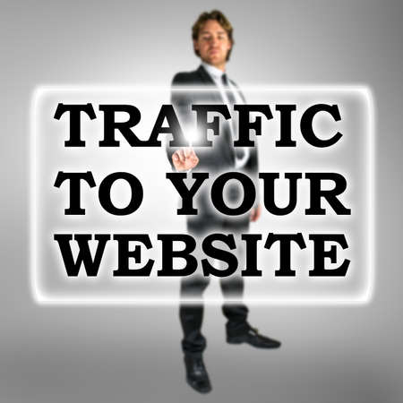 Traffic To Your Website text in a bar on a virtual interface with a businessman activating the button from behind conceptual of SEO and optimising the site for search engines with keywords and links photo
