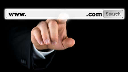 Man accessing a domain name on a virtual screen with copyspace in the navigation bar for your website address photo