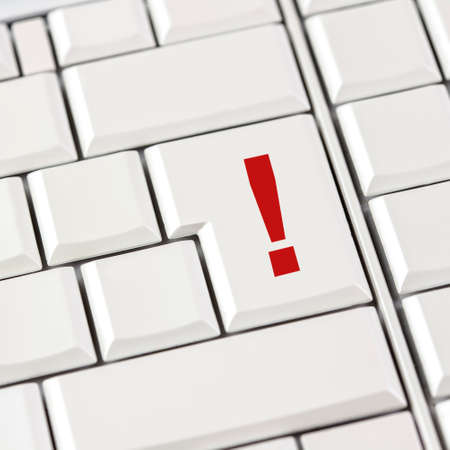 emphasis: Computer keyboard with white keys and a red exclamation mark on the largest key conceptual of emphasis on an online business strategy, a warning or calling attention to a web based business. Stock Photo