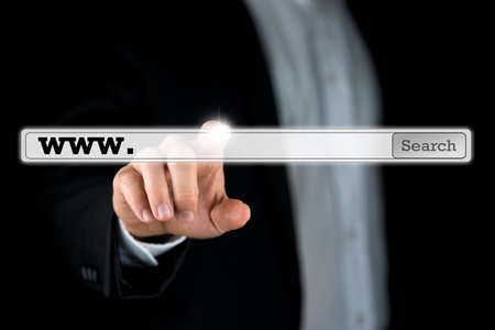 searchbar: Businessman pushing a search bar on a virtual computer screen. Empty space ready for your web address or keywords.