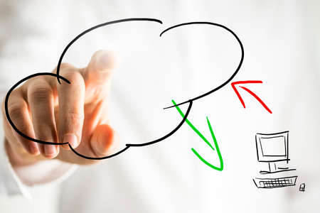 Hand drawn cloud computing pictogram on a virtual interface or screen showing a cloud symbol and computer with data transfer and a male hand touching the cloud conceptual of an online database.