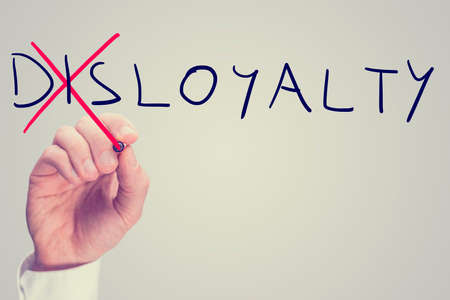 competent: Conceptual image with word Disloyalty being changed into Loyalty