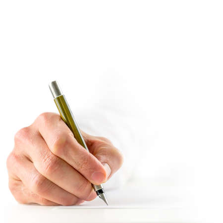 High key image with a close up view of the hand of a man in a white shirt signing a document with a fountain pen, square format conceptual image with copyspace  photo