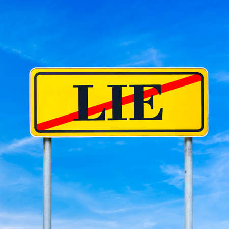 unethical: Yellow traffic sign prohibiting lying with the word - Lie - crossed through in red against a clear sunny blue sky in a conceptual image