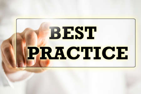 professional practice: Words Best practice on a virtual interface in a navigation bar with a businessman touching it with his finger from behind.