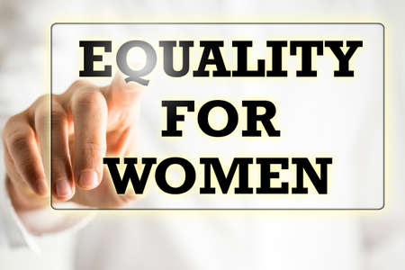 unfair: Businessman touching and activation the words - Equality For Woman - in a navigation bar or sign on a virtual screen or interface with his finger in a conceptual image.