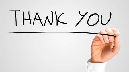 thankful: Male hand writing Thank you on virtual screen. Stock Photo