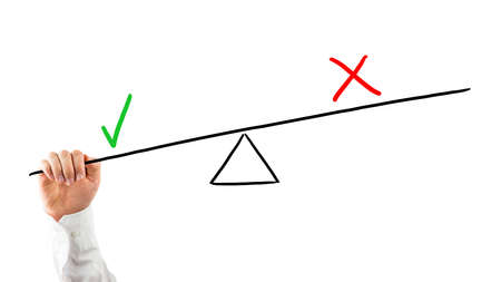 positives: Man balancing positives against negatives reaching his hand up to a seesaw with a check mark and cross pulling down on the check mark for weighted importance, on white. Stock Photo
