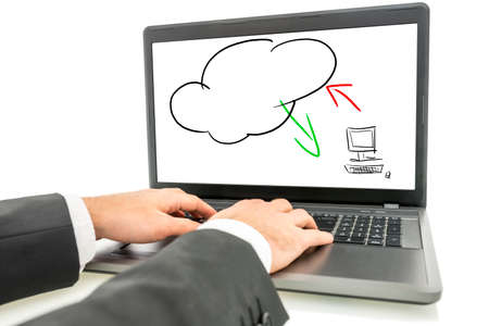 Close-up of the hands of a businessman typing on the keyboard of a laptop with the screen displaying an illustration of the cloud computing concept.