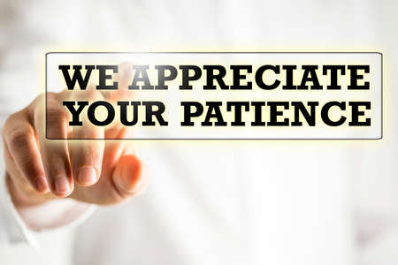 patience: The phrase We appreciate your patience on a virtual interface in a navigation bar with a businessman touching it with his finger from behind