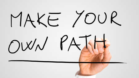 possibility: Male hand writing Make your own path on virtual screen. Concept of individuality and determination. Stock Photo
