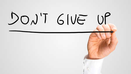 failed attempt: Male hand writing motivational message Dont give up on virtual board. Stock Photo