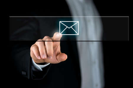 activating: Male hand activating Email button on virtual interface.