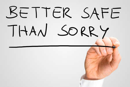 preferable: Male hand writing phrase Better safe than sorry on virtual screen.