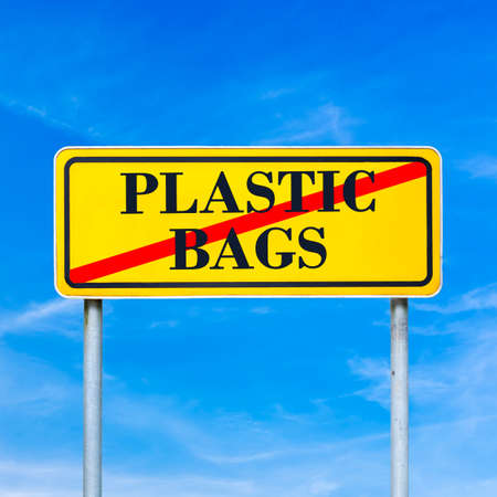 plastic bag: Plastic bags crossed through with red line on yellow road sign. Conceptual of environmental care.