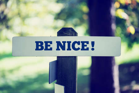Be nice signpost in beautiful woodland with a vintage instagram style filter effect. Stock Photo