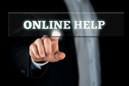 activating: Male hand activating an Online help button on virtual screen. Stock Photo