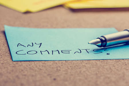 Close up of the nib of a fountain pen lying on a sheet  photo