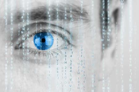 ojo humano: Imagen futurista con el ojo humano con el iris azul y la matriz de textura. Foto de archivo