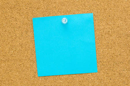Blank blue note paper pinned on a cork bulletin board. Stock Photo - 29391417