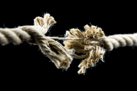 Closeup of frayed rope about to break.