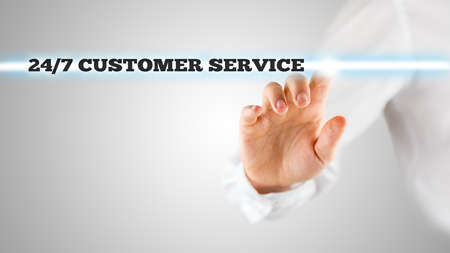 activating: Male hand activating a 247 customer service button on virtual screen. Stock Photo