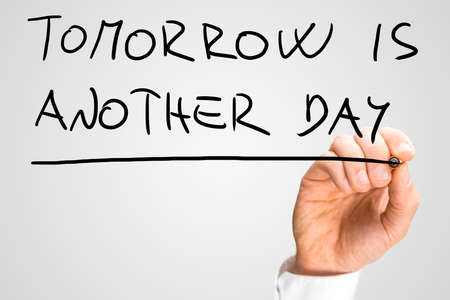 better days: Male hand writing phrase Tomorrow is another day on virtual screen. Stock Photo