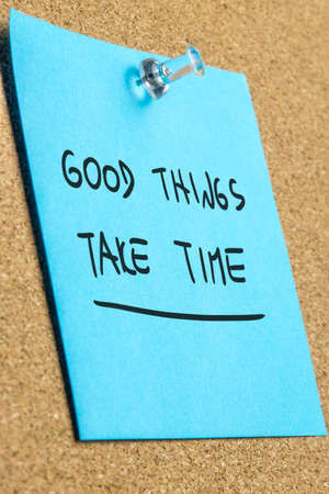 Good things take time written on blue paper. photo