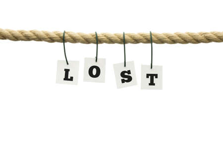 vanished: Word - Lost - with individual alphabet letters each attached by a wire hanging from a rope over white in a conceptual image with copyspace.