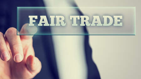trade fair: Retro Style Image of a Macro Man Pointing on Fair Trade White Texts on Vitual Screen.
