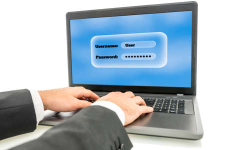 entering information: Businessman logging in on a laptop computer with the screen requesting his username and password as identification and security for access.