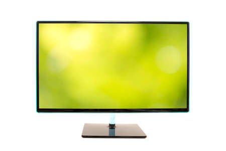 hd tv: Computer monitor with an image of a blurred green natural background on the screen in horizontal orientation isolated on white background.
