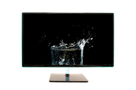 high definition: High definition modern computer monitor or television screen showing an image of splashing water on a dark background, isolated on white.