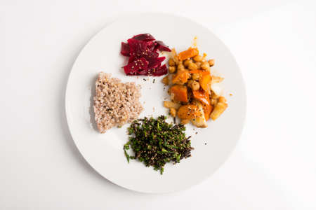 macrobiotic: Top view of nutritious macrobiotic plate - buckwheat, seaweed with chives, chickpeas with vegetables and redd beets.