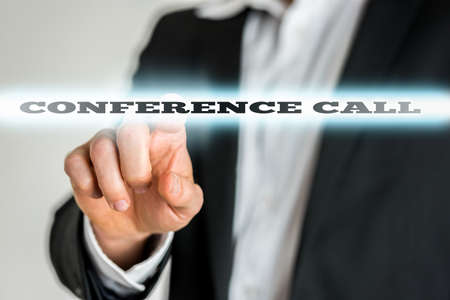 Businessman Pointing by Finger Glowing Conference Call Texts. photo