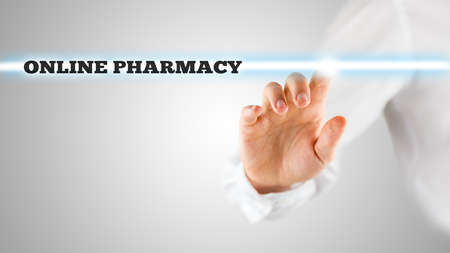 activating: Man activating an online pharmacy search bar on a virtual screen with his finger conceptual of online medical advice and medication. Stock Photo