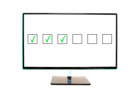 Flat Wide Monitor Screen on Stand Flashing Check Boxes. photo