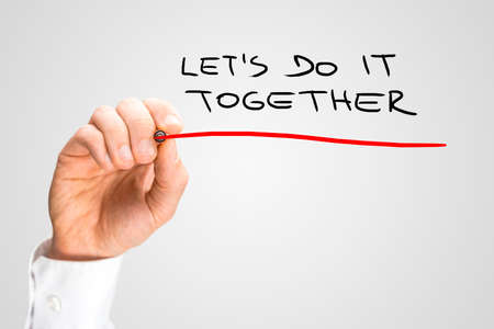 Close up Conceptual Handwritten Red Underline on Lets Do It Together Texts Isolated on Gray Background. Stock Photo