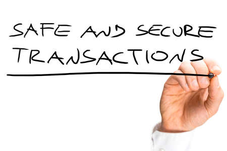electronic transaction: Male hand writing Safe and secure transactions sign on virtual screen.