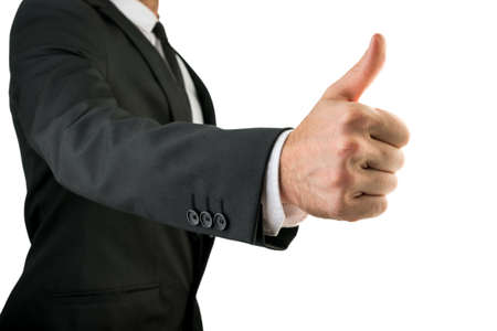 well done: Businessman in Black Suit Showing Thumbs Up Sign, Emphasizing Approval or Satisfaction. Isolated on White Background.