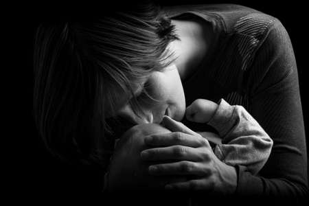 Black and White Image of Mother Tenderly Nuzzling and Touching Baby. Stock Photo