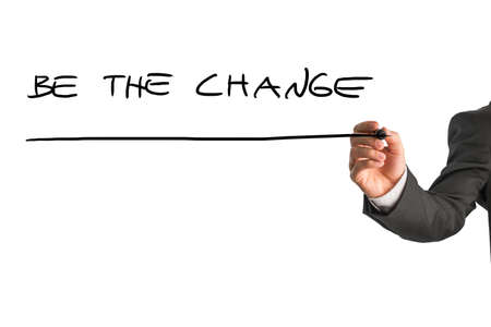 be the change: Businessman writing - Be the change - with a black marker pen on a virtual screen over white with plenty of copyspace in an inspirational concept. Stock Photo