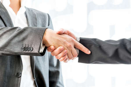 Close up Two Businessmen in Suit Showing Hand Shake Gesture Inside the Office. photo